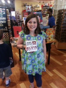 The beautiful Molly with our Elvis book at Graceland